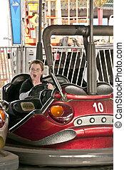 Bumper Cars - A young boy driving a bumper car