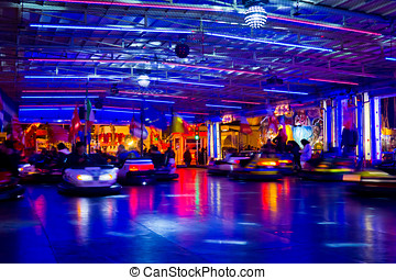 bumper cars at the lunpark under a blue light at night