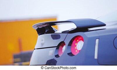 Bumper of bright dark blue new car. Presentation. Red...