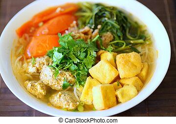 Bun Rieu or Vietnamese vermicelli noodle soup with milled crab meat