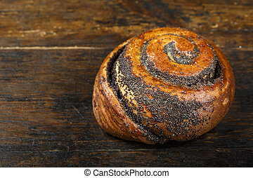 bun with poppy seeds place for text