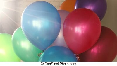 Bunch colorful helium balloons sunlight unfocused - Bunch of...