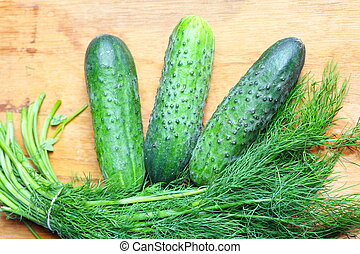 bunch fresh dill and cucumbers on wooden table - bunch fresh...