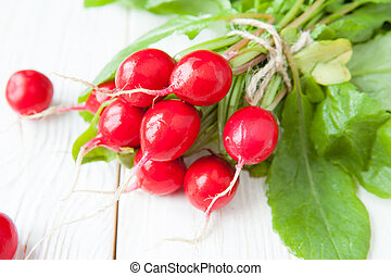 bunch fresh radish with leaves on the boards
