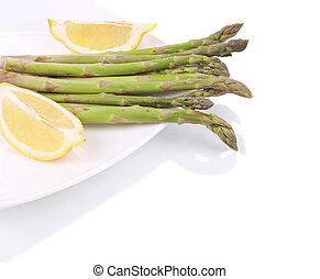 Bunch of asparagus on a plate.
