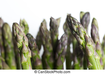 Bunch of asparagus on dark table. Organic, vegetarian and healthy food concept. Closeup. Copy space. Top view
