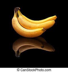 Bunch of bananas on a black background isolated