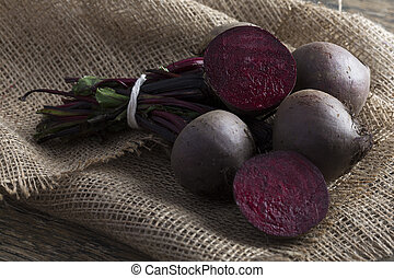 Bunch of beetroot on a brown burlap cloth close-up