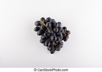bunch of black grapes close-up on a white background