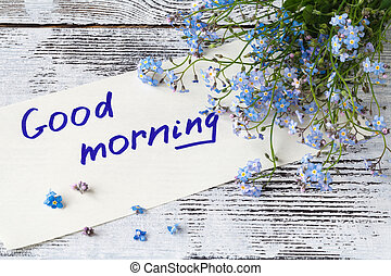 Bunch of blue flowers (forget-me-nots) and good morning note