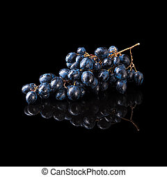 Bunch of blue grapes isolated on black