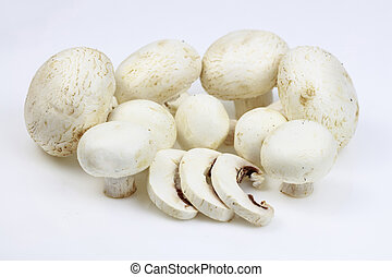 Bunch of button mushrooms with some slices, on white...