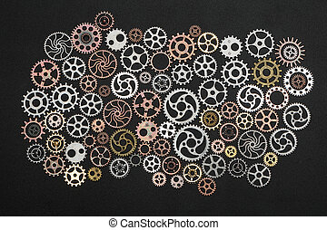 Bunch of cogwheels on black background.