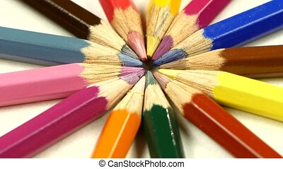 Bunch of colored pencils on white, rotation, macro, close up