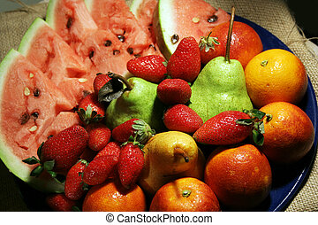 common fruits - bunch of common fruits in dish
