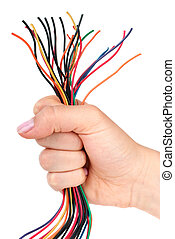 Bunch of different colored wires gripped in fist. Isolated on the white background