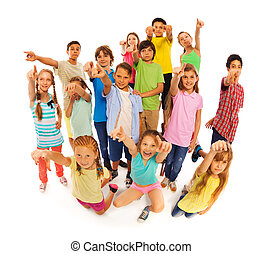 Bunch of diverse kids standing pointing at camera