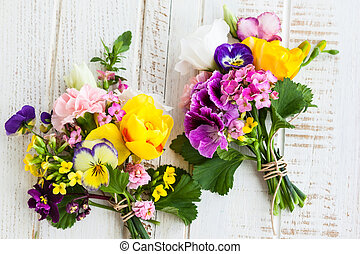 Bunch of flowers - Beautiful bunch of flowers on the wooden...