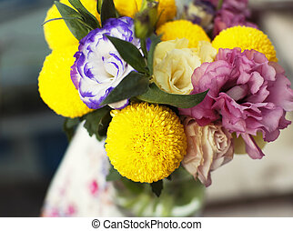 Bunch of flowers in a glass jar