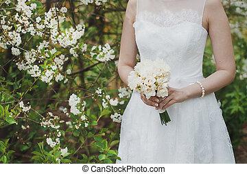Bunch of flowers in hands 1325.