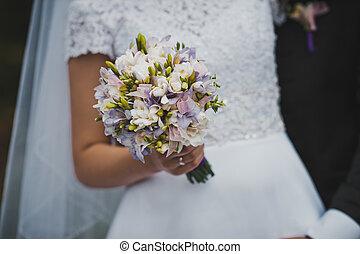 Bunch of flowers in hands of the bride 2045.