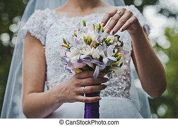 Bunch of flowers in hands of the bride 2049.