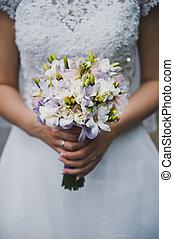 Bunch of flowers in hands of the bride 2069.