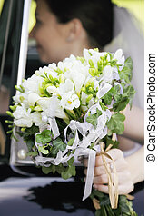 Bunch of flowers in the hand of bride