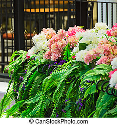 Bunch of flowers on the porch