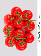 Bunch of fragrant tomato on white background.