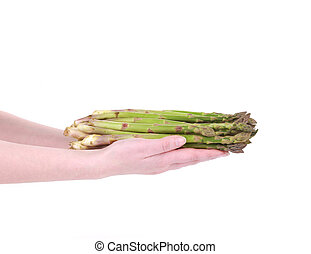 Bunch of fresh asparagus in hand.