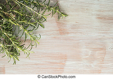 Bunch of fresh of garden rosemary on wooden table, rustic style, fresh organic herbs. Top view with copy space