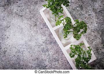 Bunch of fresh parsley on a grey background with space for text. Top view.