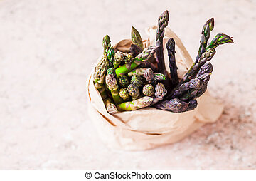 Bunch of fresh purple asparagus spears in the bag - Bunch of...