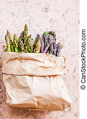 Bunch of fresh purple asparagus spears standing vertical - ...