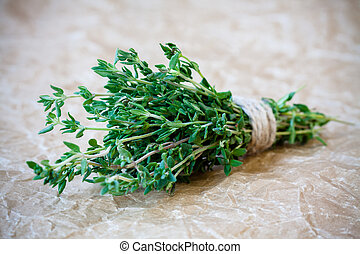 bunch of fresh thyme on a paper background