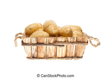 bunch of freshly harvested potatoes in a wooden basket