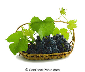 Bunch of grapes in a basket isolated on a white background