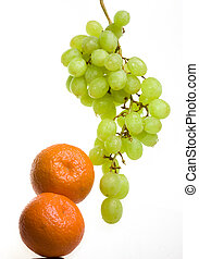Bunch of grapes in drops of water and tangerines