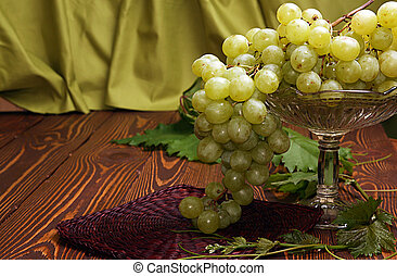 Bunch of grapes in vase for fruits