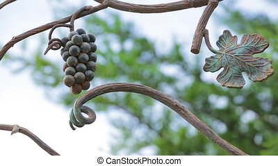 Bunch Of Grapes On a Branch Forged of Metal - Footage of a...