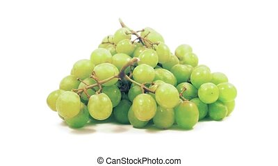 Bunch of grapes rotate slowly on white background