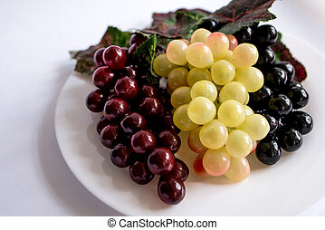 bunch of grapes with leaves on white background