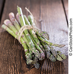 Bunch of Green Asparagus on wooden background
