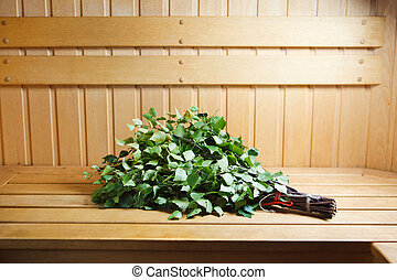 bunch of green birch twigs in sauna