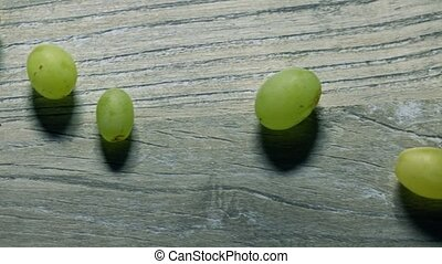 Bunch of green grapes and empty wine glass. Winery or...