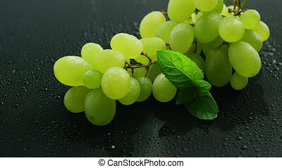 Bunch of green grapes - Closeup branch with ripe juicy grape...