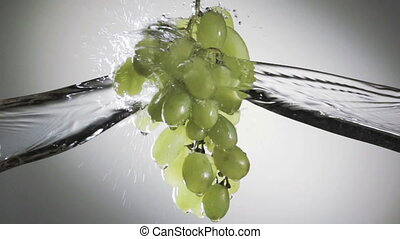 bunch of green grapes in a spray of water. HD