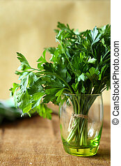 bunch of green parsley in a transparent glass