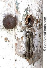 Bunch of Keys Hanging from Peeling Shed Door - bunch of keys...